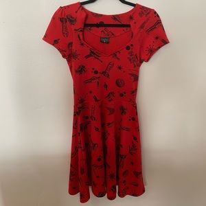 Rock steady, red space robot dress.